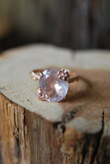 "A floral and twig band holds a beautifully cut rose quartz stone. Get it <a href=""http://shop.oldhollywoodmoxie.com/collectio"