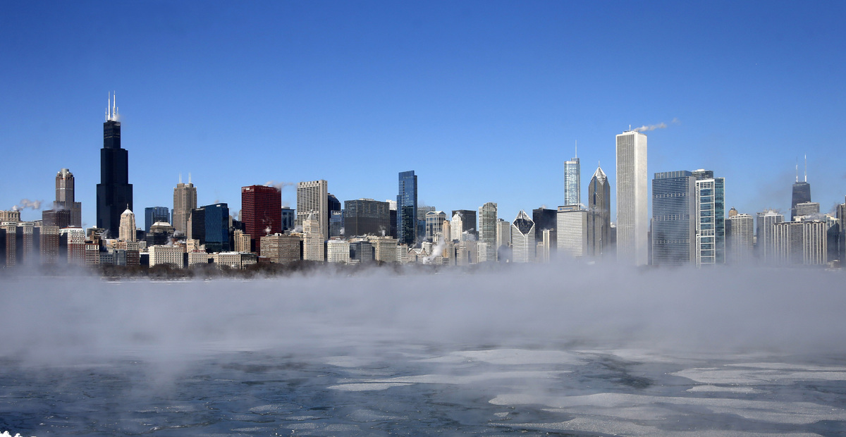 The Chicago Skyline sits as a backdrop as fog drifts across Monroe Harbor with temperatures well below zero and wind chills e