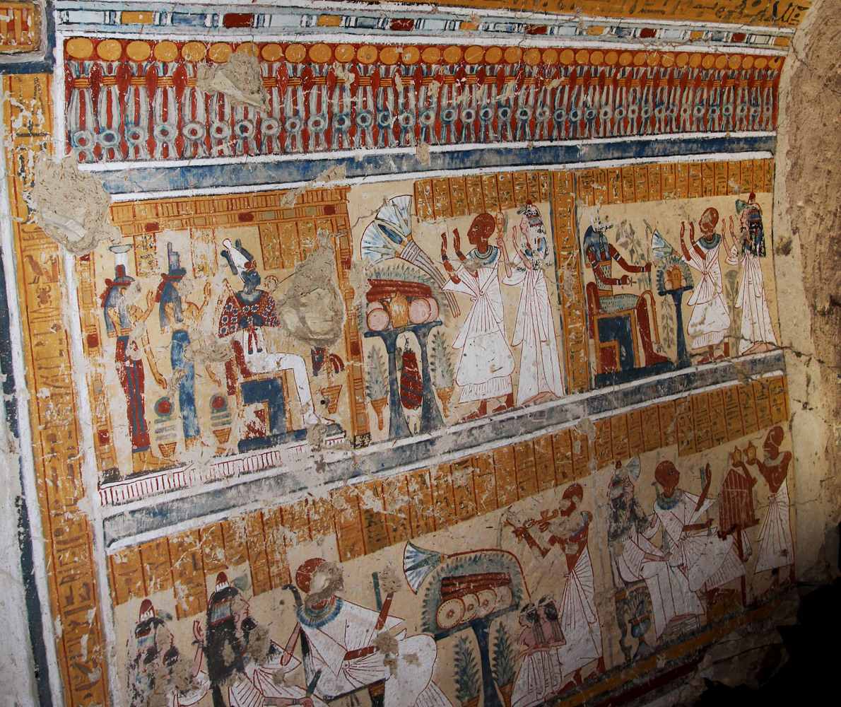 This image released by the Supreme Council of Antiquities shows colored inscriptions on a newly discovered tomb in Luxor, Egy