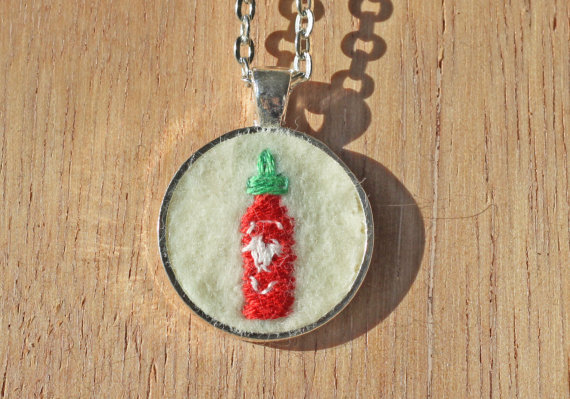 "<em><a href=""https://www.etsy.com/listing/127347298/sriracha-hot-sauce-necklace-embroidered?ref=sr_gallery_19&ga_search_query"
