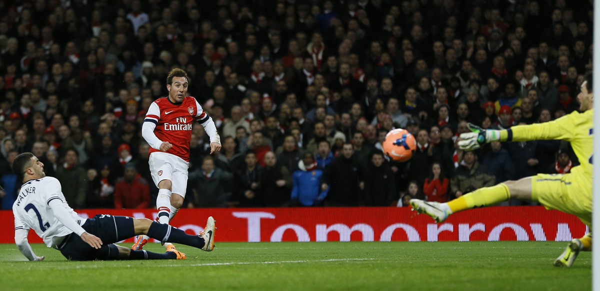 Arsenal's Santi Carzola, centre shoots and scores the opening goal during the English FA Cup third round soccer match between