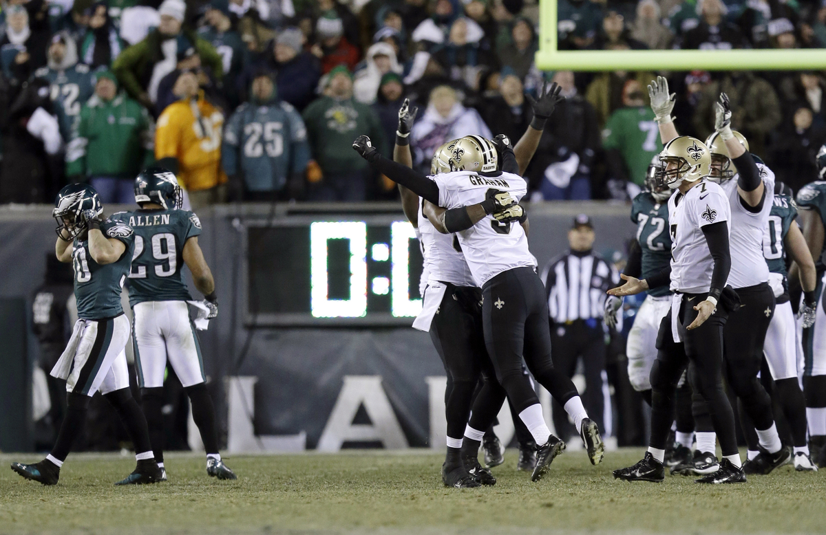 New Orleans Saints' Shayne Graham celebrates after kicking the game-winning field goal during the second half of an NFL wild-