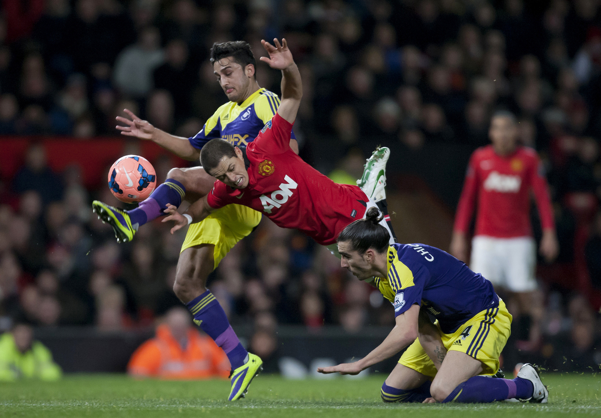 Manchester United's Javier Hernandez, centre, is brought down for a free kick by Swansea City's Chico, bottom right, as Neil