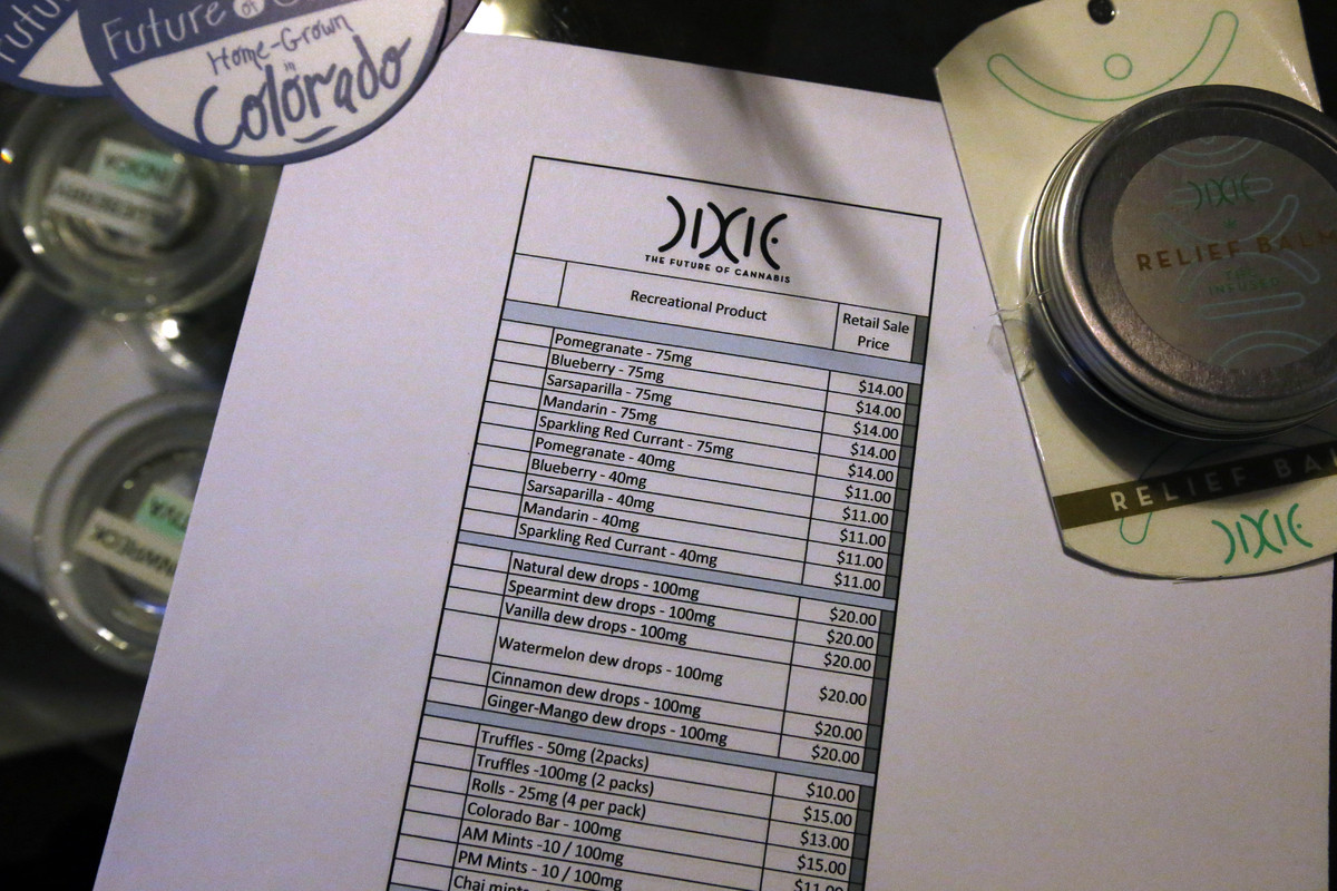 A recreational marijuana menu and price list sits on a counter at 3D Cannabis Center.