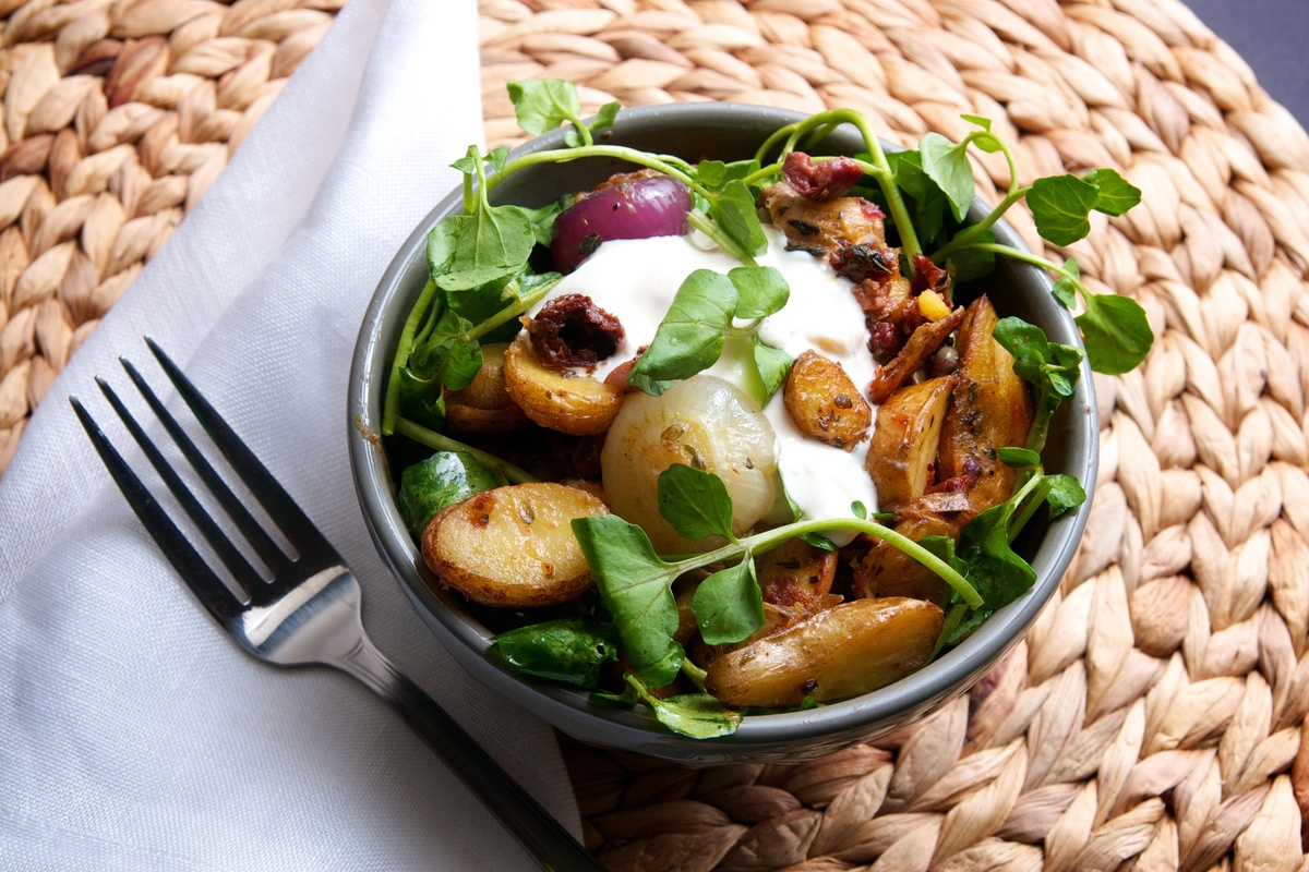 "<strong>Get the <a href=""http://food52.com/recipes/6573-roasted-fingerling-potatoes-cipollini-onions-with-cress-sundried-toma"