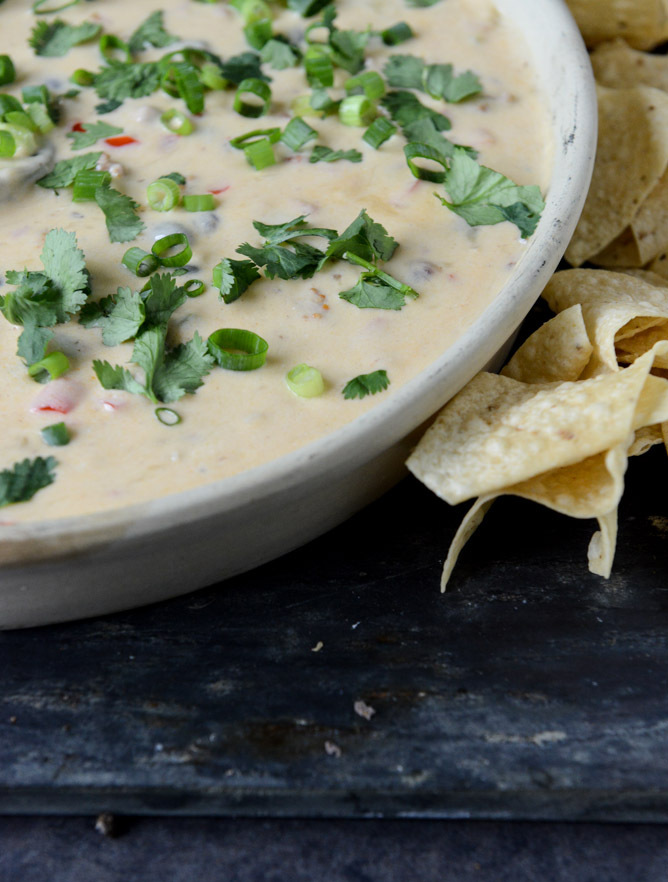 """<strong>Get the <a href=""""http://www.howsweeteats.com/2013/05/spicy-beer-queso-with-chorizo-and-black-beans/"""" target=""""_blank"""">"""