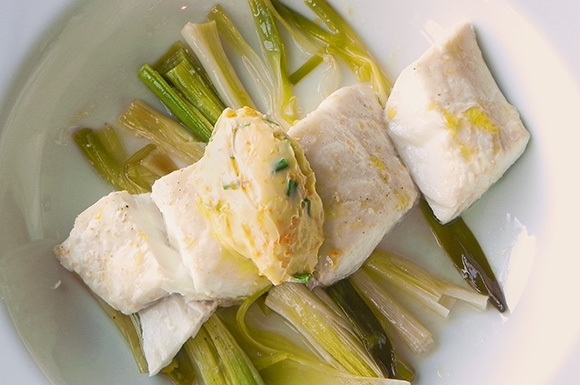 "<strong>Get the <a href=""http://food52.com/recipes/15725-roasted-halibut-leeks-with-citrus-chive-butter"">Roasted Halibut & Le"