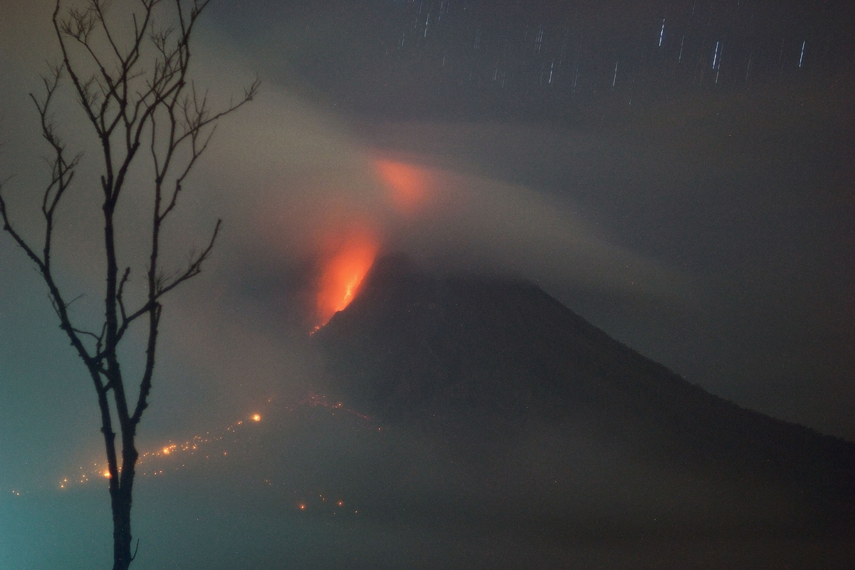 Mount Sinabung spews ash and lava during an early morning eruption near Karo, North Sumatra on January 8, 2014. An Indonesian