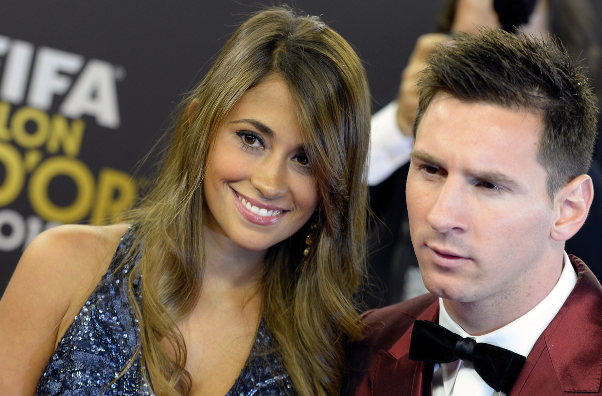 Soccer player Lionel Messi, right, of Argentina arrives with his wife Antonella, left, on the red carpet prior to the FIFA Ba