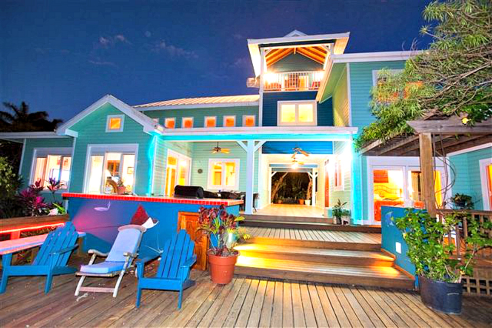 This amazing technicolored dream house is located on Roatan in the Bay Islands, home to a large expat community and terrific