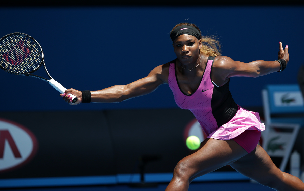 Serena Williams of the United States makes a forehand return to Vesna Dolonc of Serbia during their second round match at the