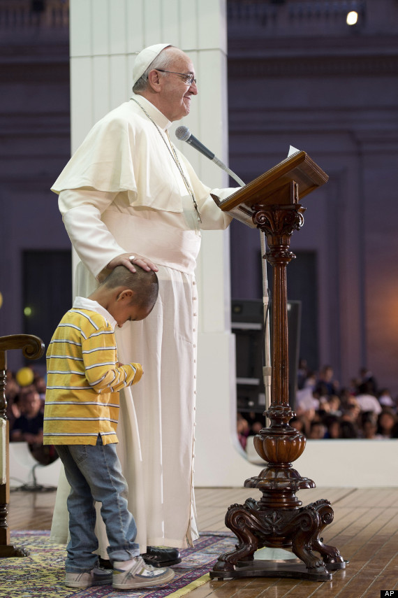 This adorable little boy was on top of the world when he made friends with Pope Francis by wandering up onto the stage during