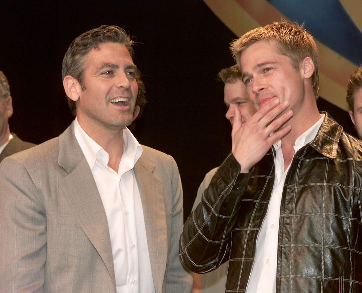 "George Clooney and Brad Pitt <a href=""http://friendship.about.com/od/Famous_Friends/ss/Famous-Celebrity-Bromances_3.htm"">met"