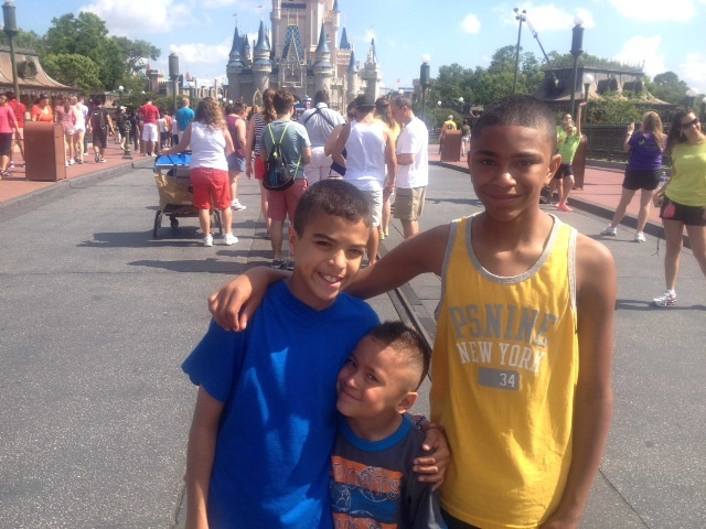Alex, Jonathan, and Daniel enjoy the sunshine at one of the happiest places on earth.