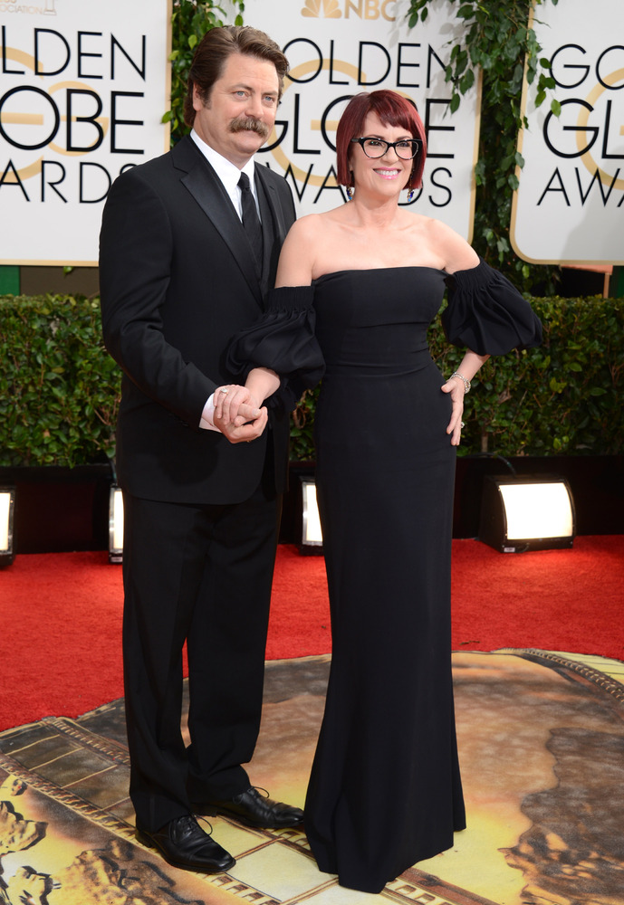 Nick Offerman, left, and Megan Mullally arrive at the 71st annual Golden Globe Awards at the Beverly Hilton Hotel on Jan. 12,