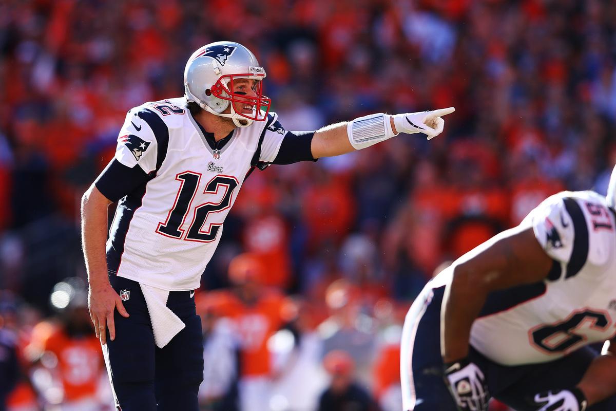 DENVER, CO - JANUARY 19:  Tom Brady #12 of the New England Patriots calls a play against the Denver Broncos during the AFC Ch