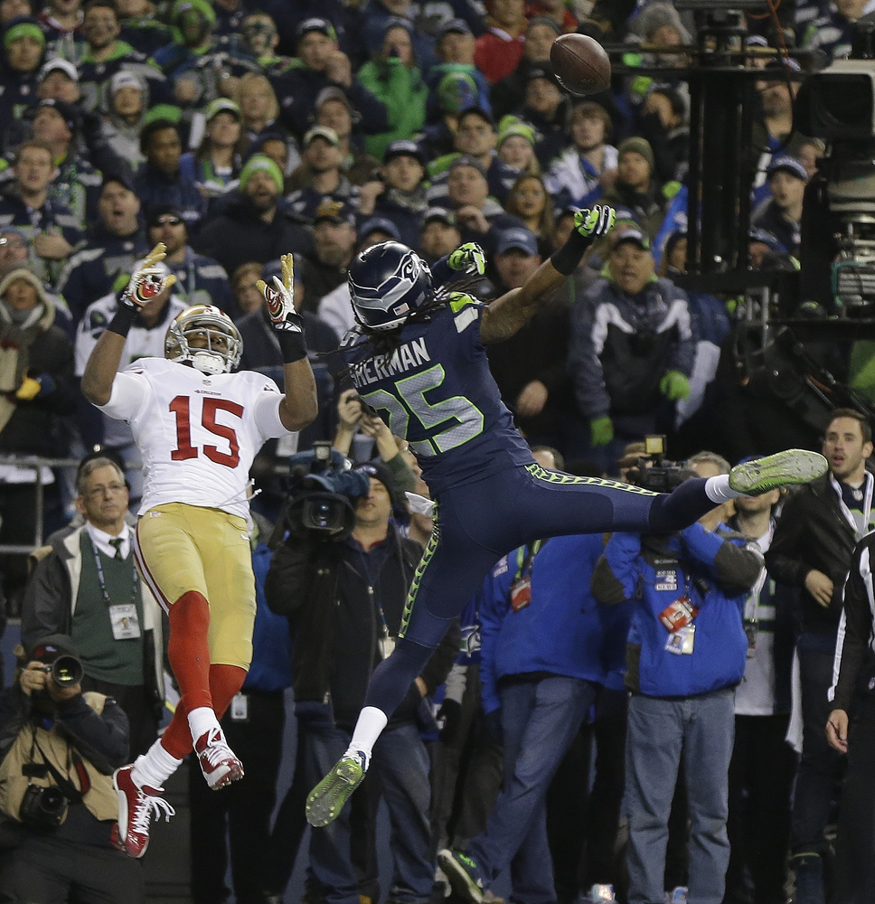 Seattle Seahawks' Richard Sherman tips a pass intended for San Francisco 49ers' Michael Crabtree (15) in the final seconds of