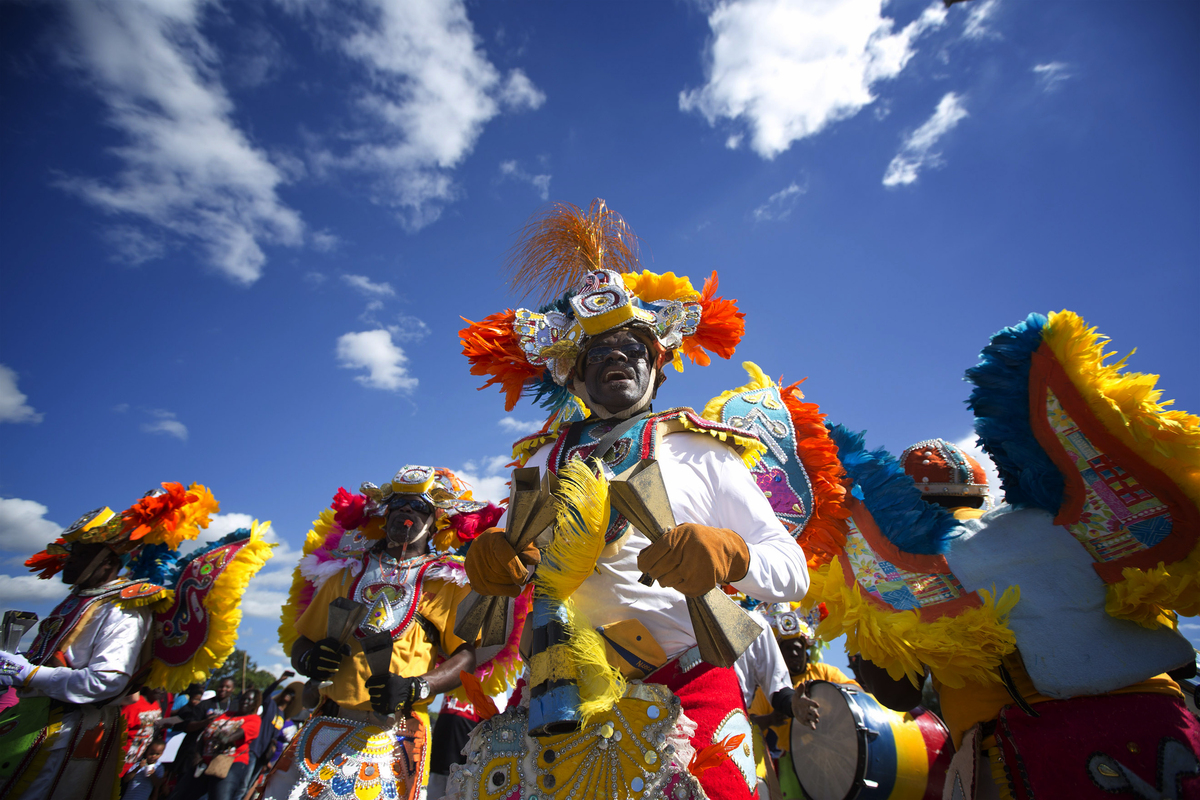 Members of a Caribbean carnival group marches in the MLK parade in Miami, Monday, Jan. 20, 2014. Dr. Martin Luther King, Jr.