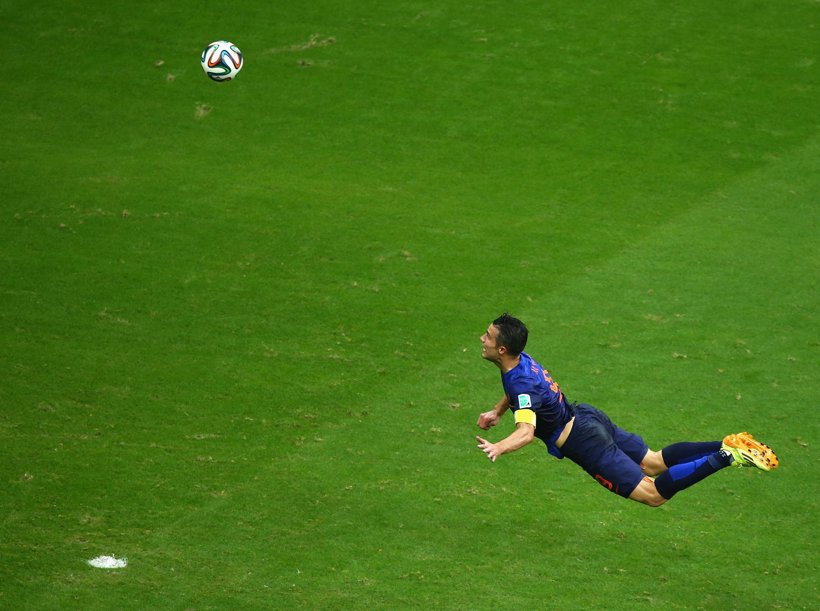 FILE - In this June 13, 2014 file photo, Netherlands' Robin van Persie heads the ball to score during the group B World Cup s