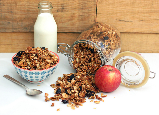 This yummy homemade granola mixed with rolled oats, coconut flakes and almonds is the perfect addition to your morning yogurt