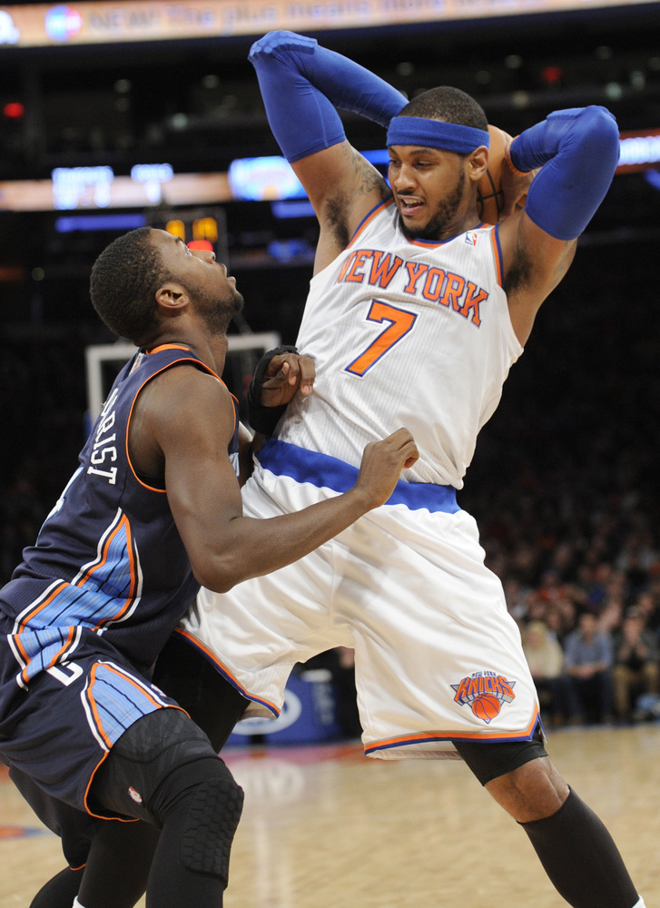 New York Knicks' Carmelo Anthony, right, makes a move as he is guarded by Charlotte Bobcats' Michael Kidd-Gilchrist during th