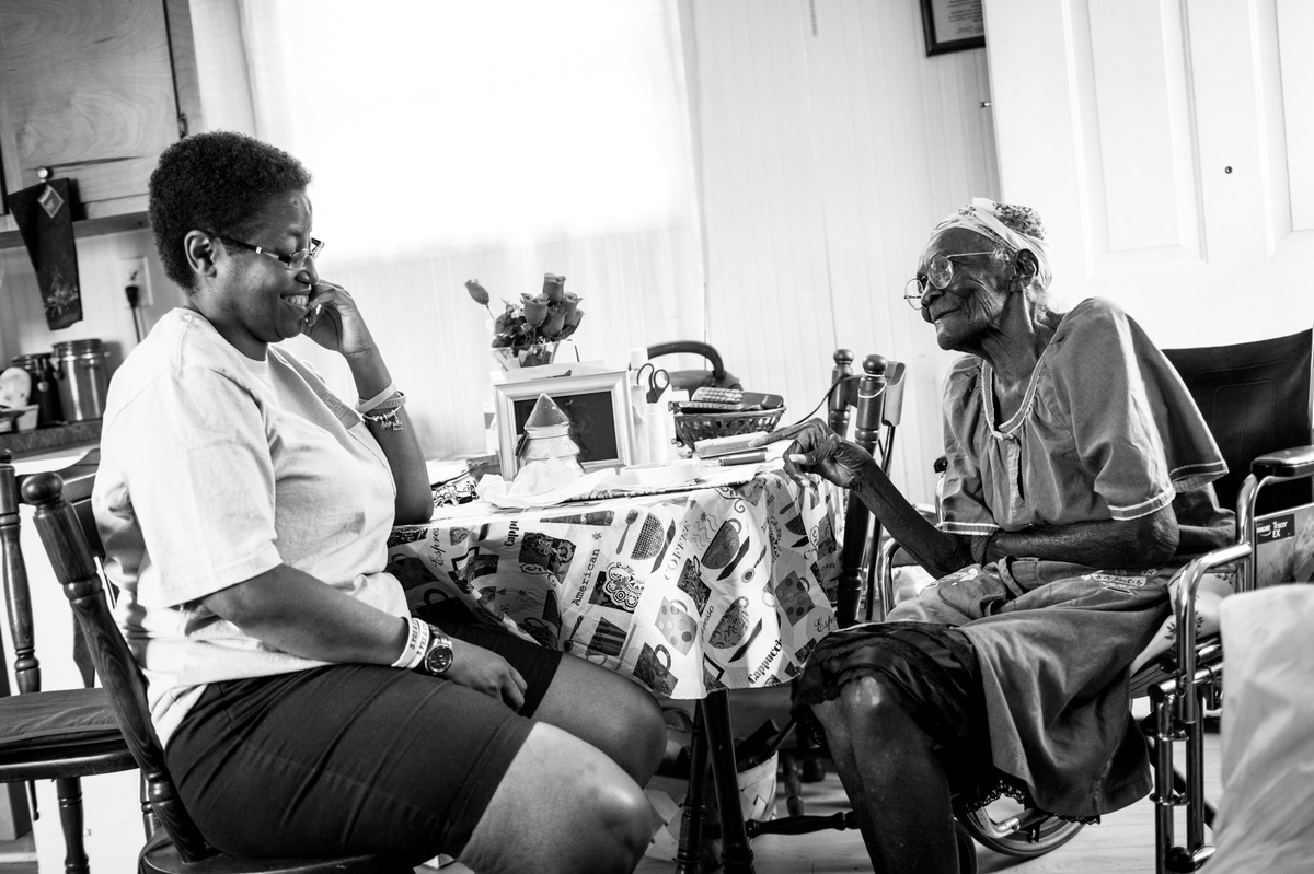 Sabrina Simone Jenkins visits with her 95-year-old great aunt, Carolia Gilliard, at her home in Awendaw, South Carolina. Sabr