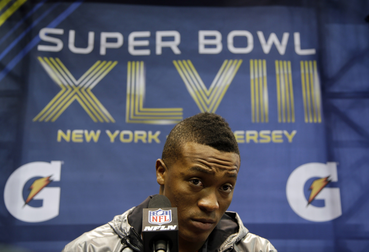 Denver Broncos' Demaryius Thomas answers a question during media day for the NFL Super Bowl XLVIII football game Tuesday, Jan