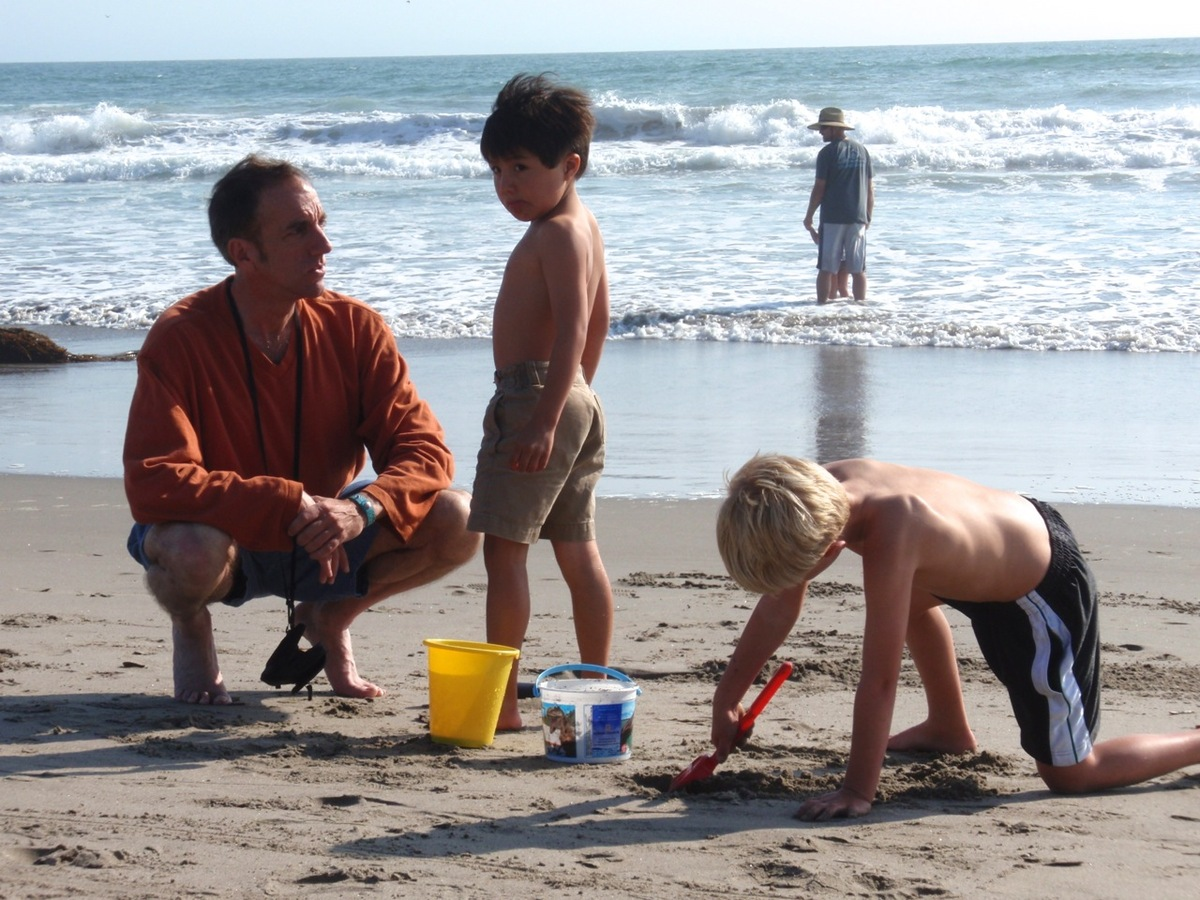 Rob and his sons Jason and Jesse enjoy family time at the beach in Santa Cruz, CA.