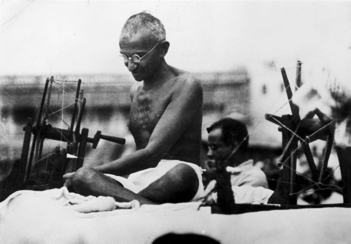 <br> Indian leader Mahatma Gandhi at a spinning wheel during a 'Charlea' demonstration in Mirzapur, Uttar Pradesh, on 9 June