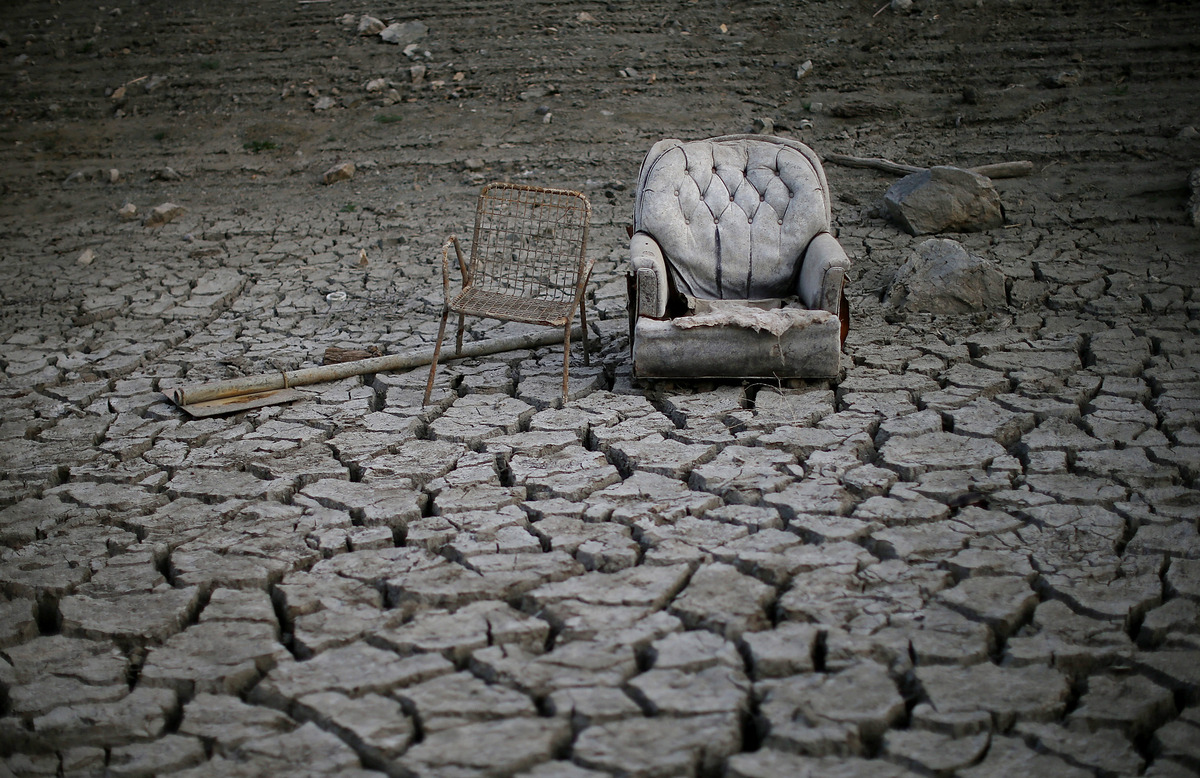 Chairs sit in dried and cracked earth that used to be the bottom of the Almaden Reservoir on January 28, 2014 in San Jose, Ca