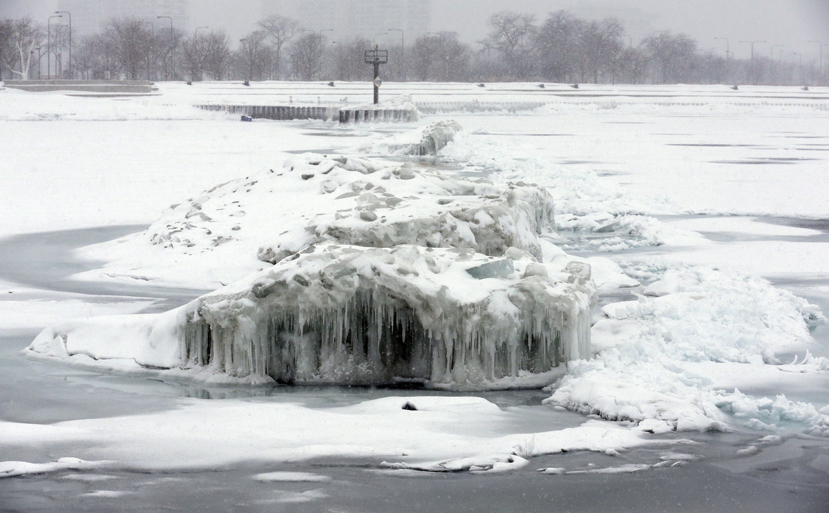 The pier at 31st Street is coated with ice during a snowy day in Chicago, Saturday, Feb. 1, 2014. (AP Photo/Nam Y. Huh)