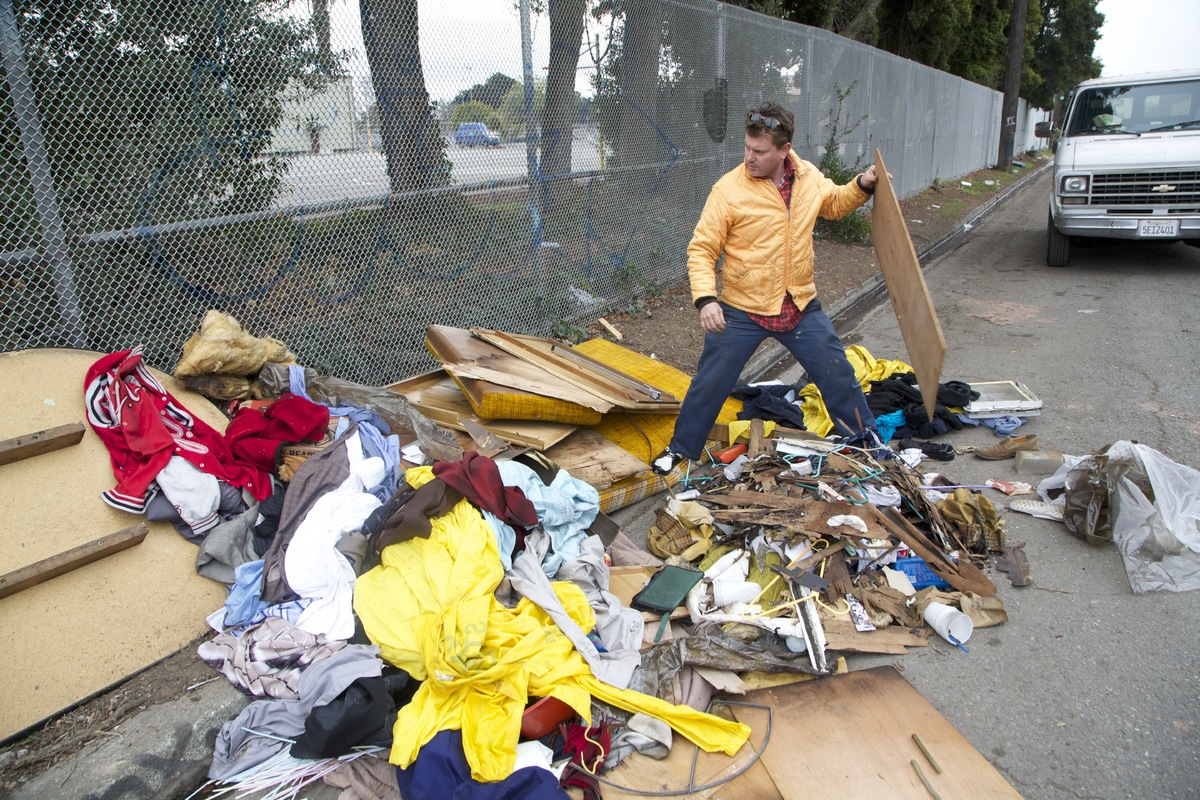 Artist Gregory Kloehn digs through garbage to gather materials to make shelters for the homeless.