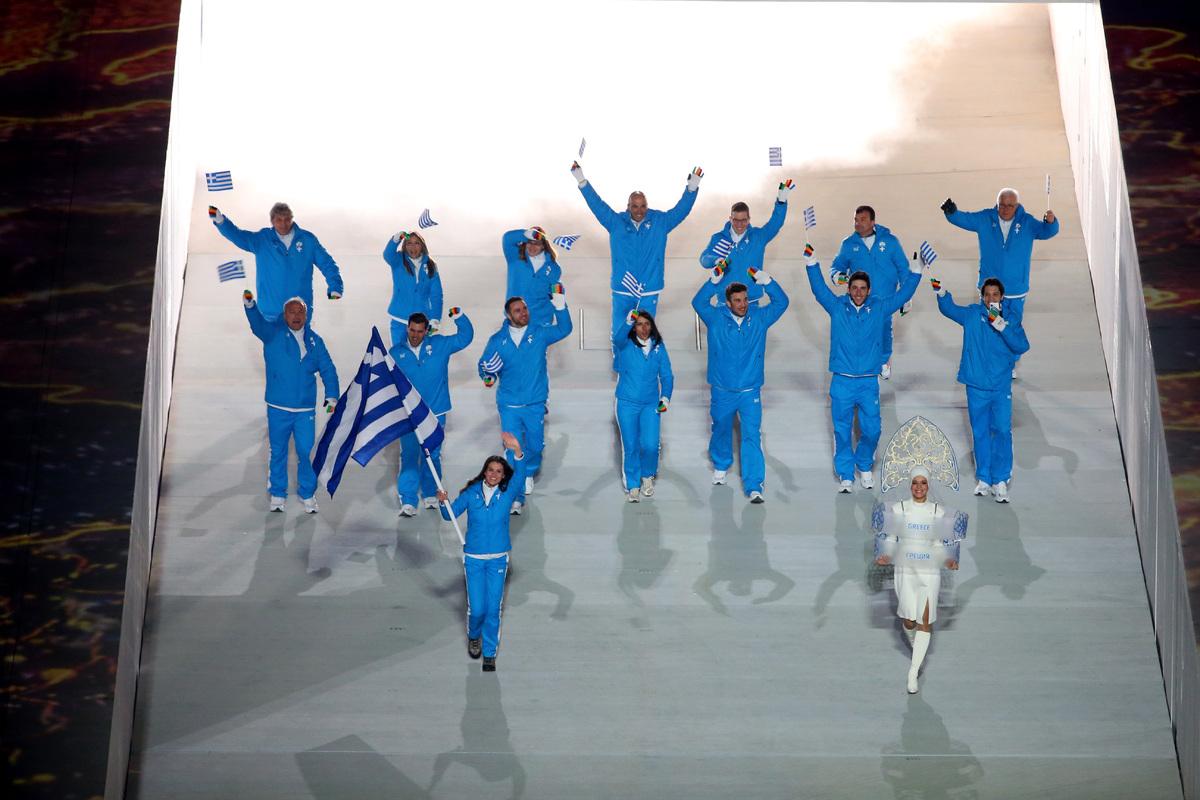 SOCHI, RUSSIA - FEBRUARY 07:  Cross country skier Panagiota Tsakiri of the Greece Olympic team carries her country's flag dur