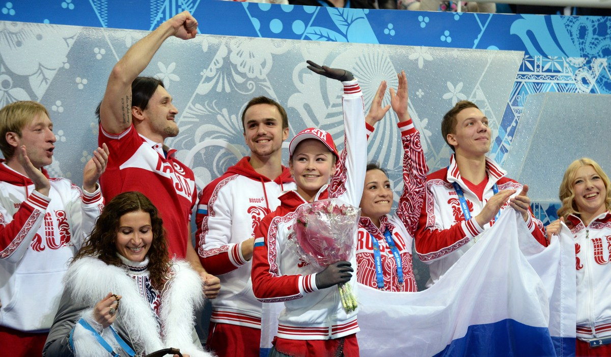 Russia's Julia Lipnitskaia celebrates with her team after she performs in the Women's Figure Skating Team Free Program at the