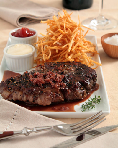 "<strong>Get the <a href=""http://www.hungrycravings.com/2010/11/peppercorns-on-vine-and-steak-au-poivre.html"">Steak au Poivre"
