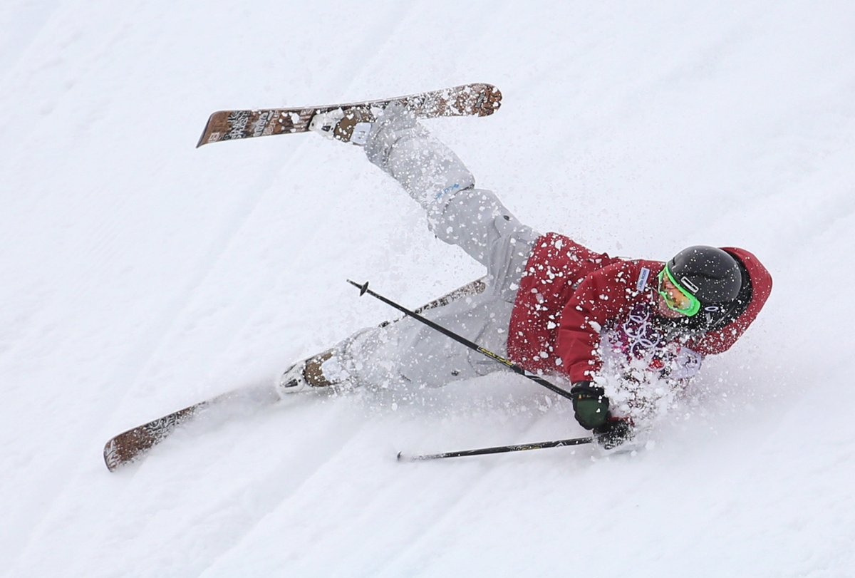 Kim Lamarre, of Canada, crashes during the ladies' ski slopestyle at the Rosa Khutor Extreme Park during the Winter Olympics