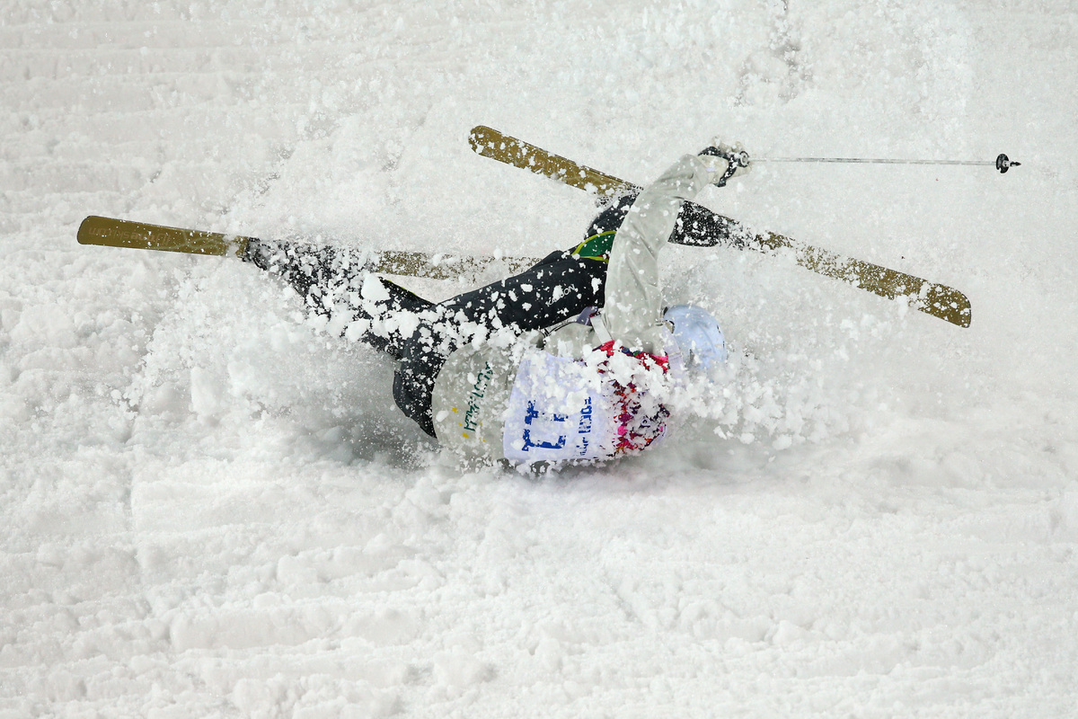 SOCHI, RUSSIA - FEBRUARY 10: Dale Begg-Smith of Australia crashes out in the Men's Moguls Qualification on day three of the S