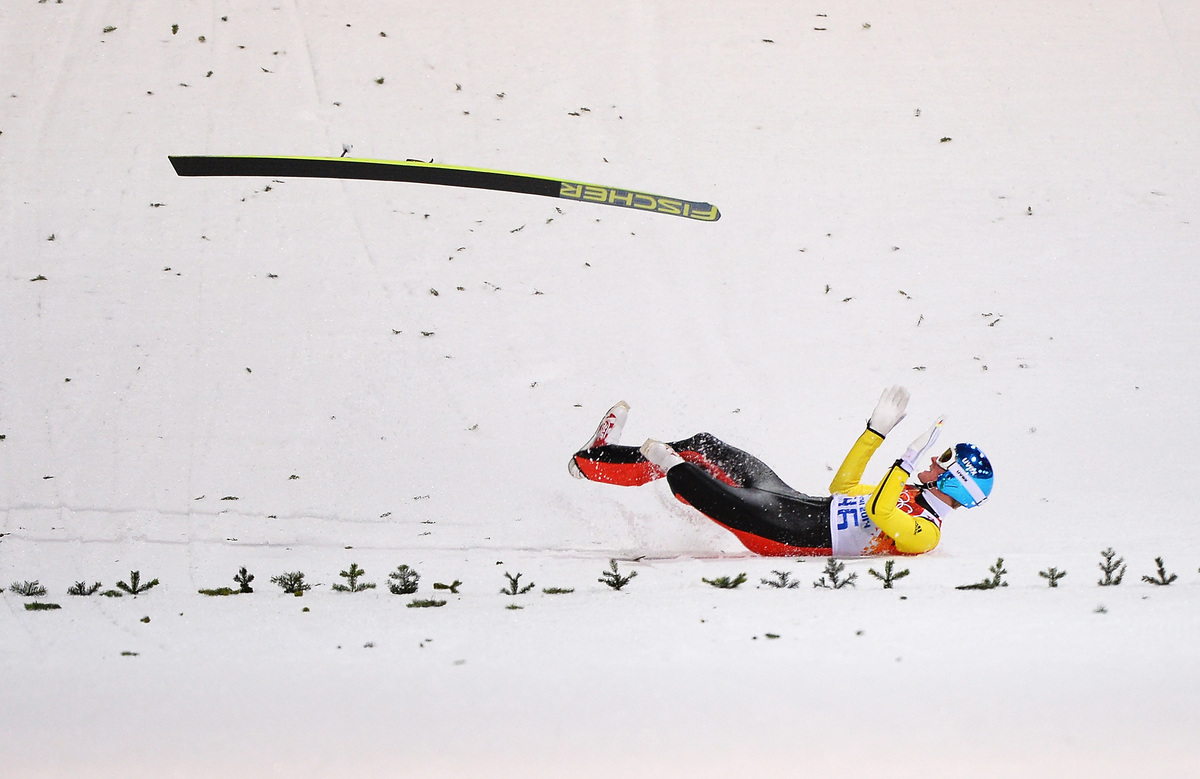 SOCHI, RUSSIA - FEBRUARY 09: Severin Freund of Germany crashes upon landing during the Men's Normal Hill Individual first rou