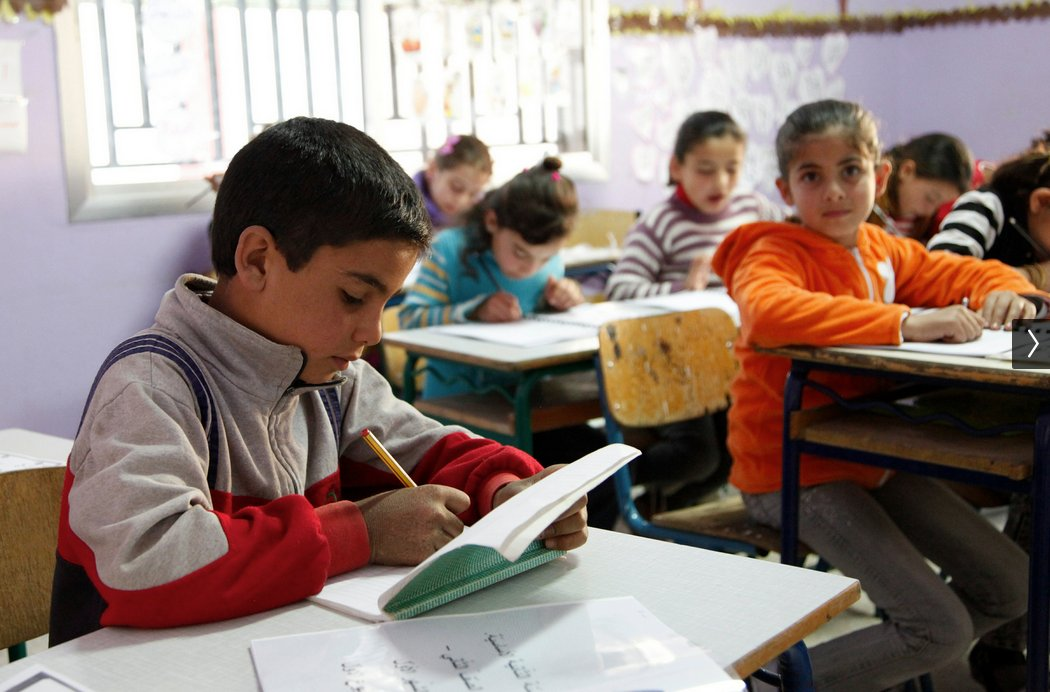 An 11-year-old refugee at school in Lebanon, where aid is helping provide education to thousands of children.