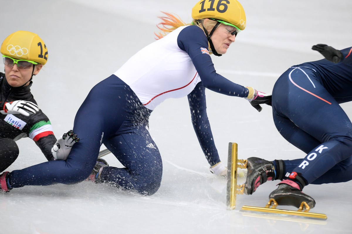 (L-R) Italy's Arianna Fontana, Great Britain's Elise Christie and South Korea's Park Seung-Hi fall as they compete in the Wom
