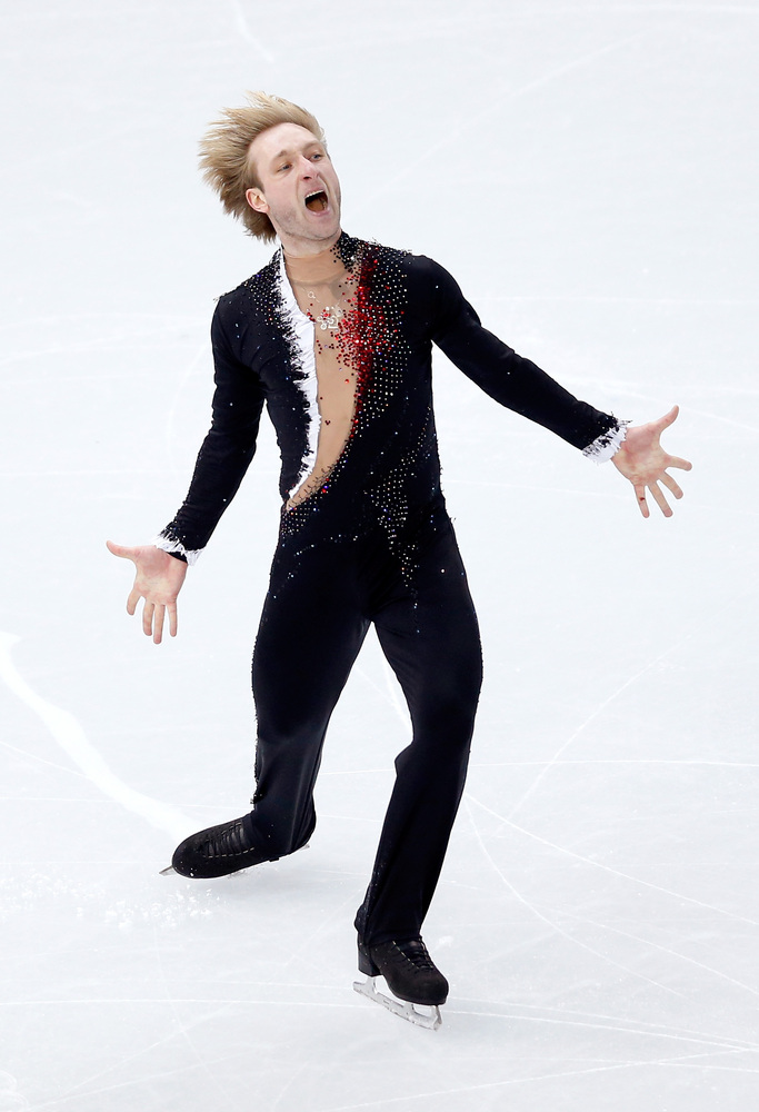 Evgeny Plyushchenko of Russia competes in the Figure Skating Men's Short Program during the Sochi 2014 Winter Olympics at Ice