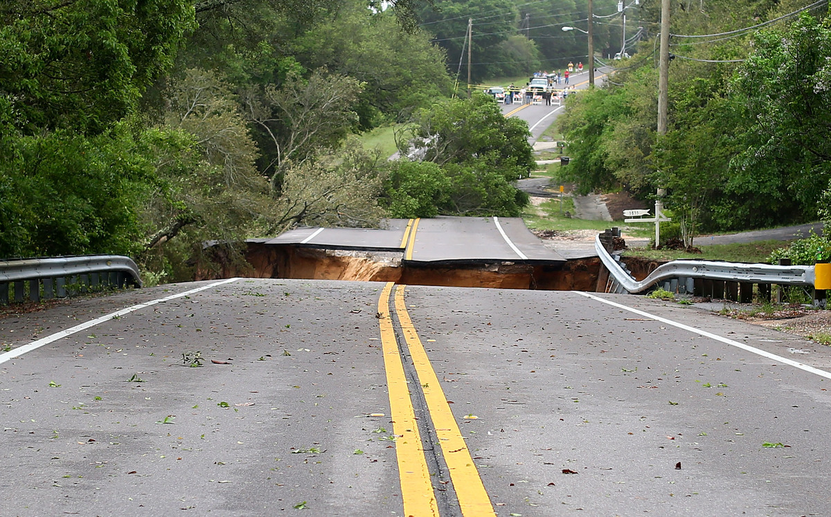 PENSACOLA, FL - APRIL 30:  A sinkhole on Scenic Highway after part of the highway collapsed following heavy rains and flash f