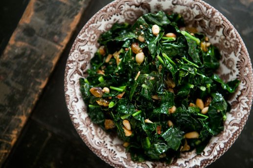 """<strong>Get the <a href=""""http://www.simplyrecipes.com/recipes/sauteed_greens_with_pine_nuts_and_raisins/"""">Sautéed Greens with"""