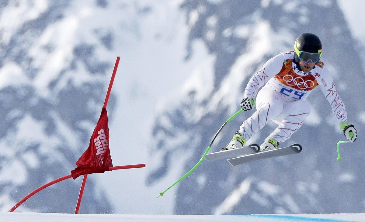 United States' Andrew Weibrecht makes a jump to win the silver medal in the men's super-G at the Sochi 2014 Winter Olympics,
