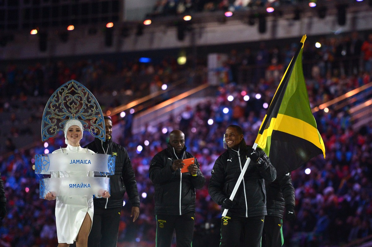 Jamaica's flag bearer, bobsledder Marvin Dixon, leads his national delegation during the Opening Ceremony of the 2014 Sochi W