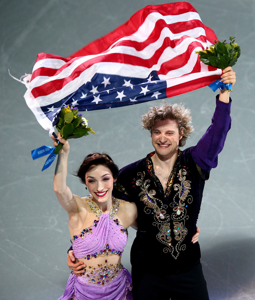SOCHI, RUSSIA - FEBRUARY 17:  Gold medalists Meryl Davis and Charlie White of the United States celebrate during the flower c