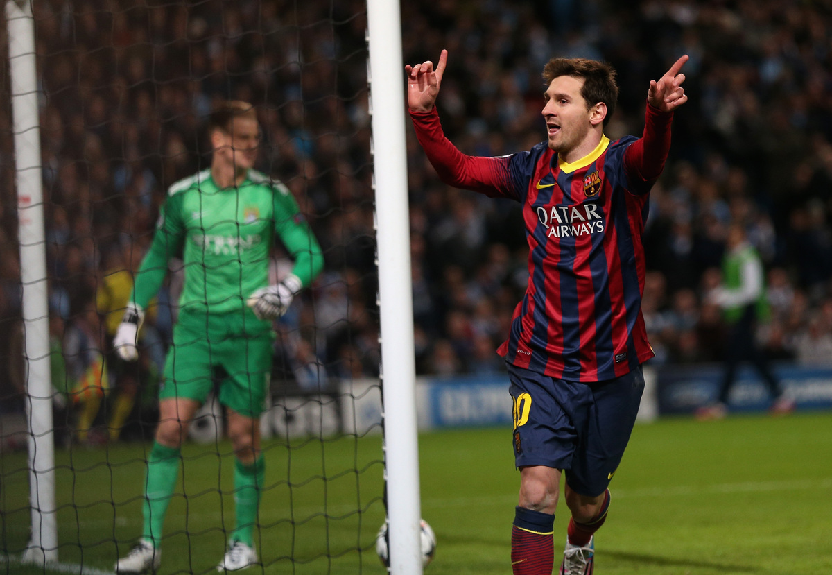 MANCHESTER, ENGLAND - FEBRUARY 18:  Lionel Messi of Barcelona celebrates scoring the opening goal from a penalty kick during