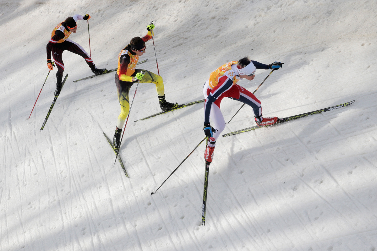 Bernhard Gruber of Austria, Johannes Rydzek of Germany and Magnus Krog of Norway compete in the 2014 Winter Olympics Nordic C