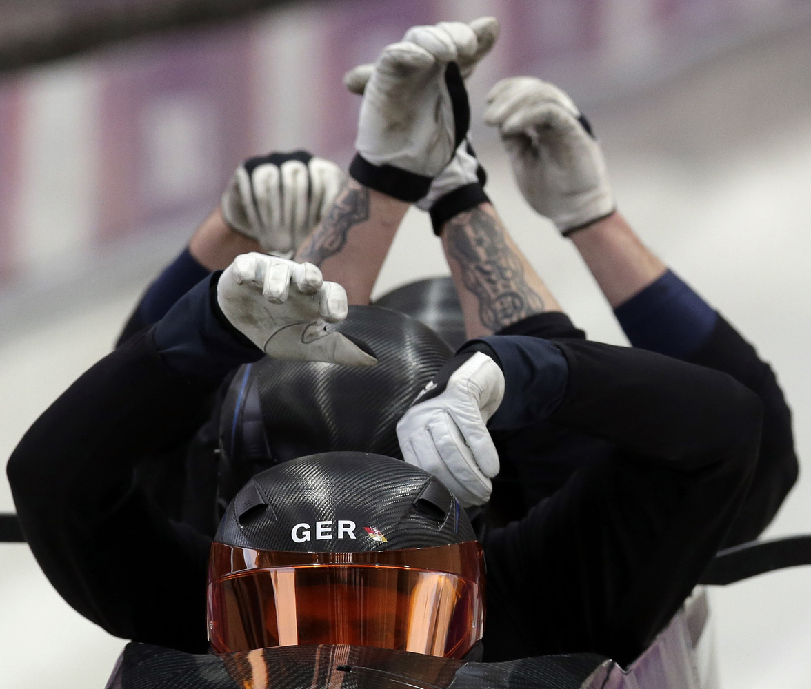 The team from Germany, piloted by Maximilian Arndt, start a run during the men's four-man bobsled training at the 2014 Winter