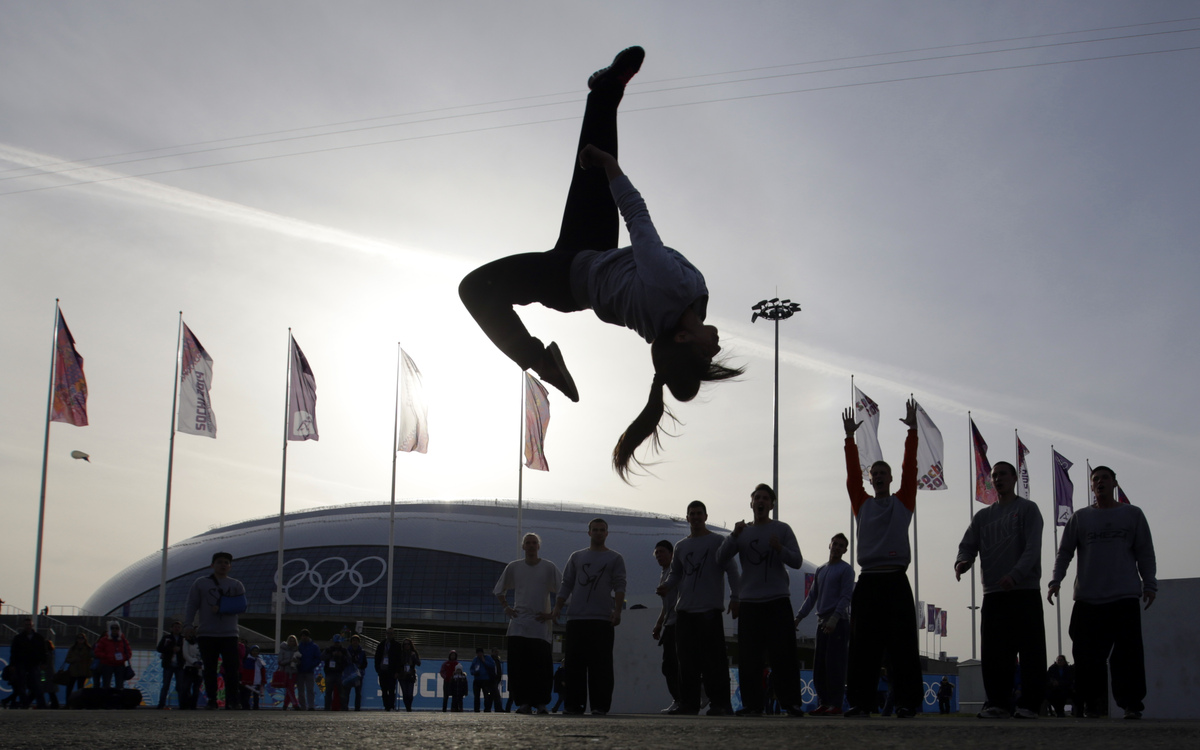 Nino Deisadze, an actress with the acrobatic group Jump Evolution, performs a backflip in front of the Bolshoy Ice Dome while